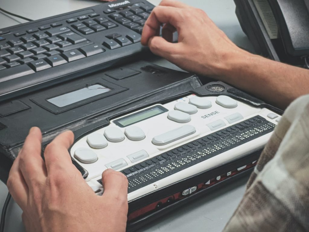 Person using braille display